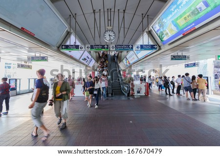 BANGKOK - DECEMBER 5: Passengers walk in BTS elevated rails in Siam Station on December 5, 2013 in Bangkok, Thailand. It's the first electric train system in Thailand. - stock photo