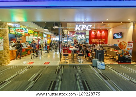 BANGKOK - DECEMBER 18: Subway and KFC restaurant in Don Mueang International Airport on Dec 18, 13 in Bangkok. It is considered to be one of the worlds oldest international airports. - stock photo