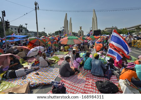BANGKOK - DECEMBER 22: Thai people protest against corruption of the Thaksin government at Democracy Monument area on December 22, 2013 in Bangkok, Thailand.