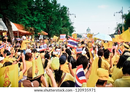 BANGKOK - DECEMBER 5: Thai people sit outside to celebrate for the 85th birthday of HM King Bhumibol Adulyadej on December 5, 2012 in Bangkok, Thailand.