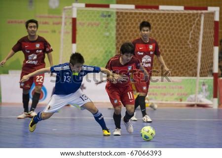 BANGKOK - DECEMBER 12 : Thailand vs Japan Bangkok Futsal Super Match 2010.Kazuhiro Nibuya (Blue) and Nattavut Madyalan(Red) on DECEMBER 11 -12 2010 in Bangkok Thailand. - stock photo
