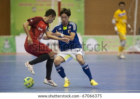 BANGKOK - DECEMBER 12 : Thailand vs Japan Bangkok Futsal Super Match 2010.Kohei Harada (Blue) and Lertchai issarasuwipakorn(Red) on DECEMBER 11 -12 2010 in Bangkok Thailand. - stock photo