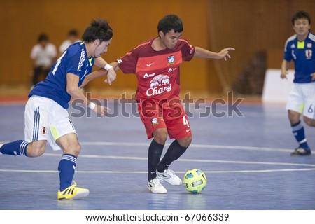BANGKOK - DECEMBER 12 : Thailand vs Japan Bangkok Futsal Super Match 2010.Kohei Harada( left) and Jirawat Sornwichian (right) on DECEMBER 11 -12 2010 in Bangkok Thailand. - stock photo