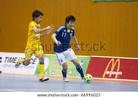 BANGKOK - DECEMBER 11 : Thailand vs Japan, Bangkok Futsal Super Match 2010,Kritsada Wongdaeo (L) and Kazuhiro Nibuya (R) on DECEMBER 11 -12, 2010 in Bangkok Thailand.