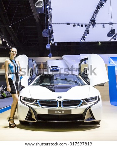 Bangkok - December 28 : Unidentified model and white BMW series I8 whlie open Gull-wing door - in display at Thailand international motor expo 2014 on December 28, 2014 in Bangkok Thailand