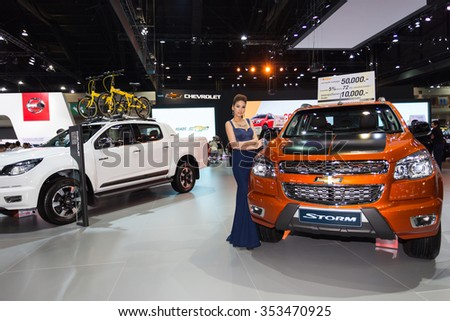 BANGKOK - December 11, 2015 : Unidentified model with Chevrolet Storm car on display at the 32nd Thailand International Motor Expo 2015 on December 11, 2015 in Bangkok, Thailand. - stock photo