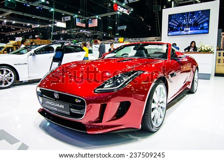 BANGKOK - DECEMBER 4 : Unidentified model with Jaguar F-Type on display at The 31st Bangkok International Motor Expo on DECEMBER 4, 2014 in Bangkok, Thailand. - stock photo