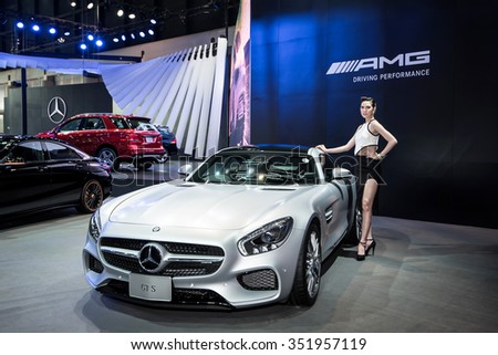 BANGKOK - DECEMBER 11, 2015 : Unidentified model with Mercedes-Benz car on display at The 32nd Bangkok International Motor Expo on DECEMBER 11, 2015 in Bangkok, Thailand.