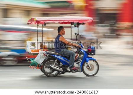 BANGKOK - DECEMBER 12: variety of a Tuk-tuk moto taxi on the street in Chinatown on December 12, 2014 in Bangkok. The bangkok moto-taxis called tuk-tuk are a landmark of the city and popular transport - stock photo