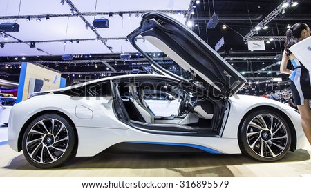 Bangkok - December 28 : white BMW series I8 white open Gull-wing door - in display at Thailand international motor expo 2014 on December 28, 2014 in Bangkok Thailand