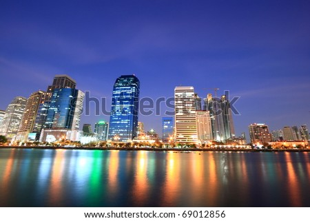 Bangkok Downtown at Night Time with Reflection - stock photo