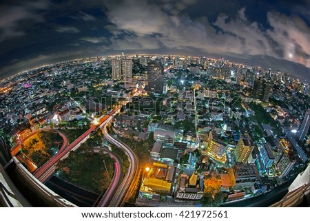 Bangkok expressway , motorway and highway top view with many building at night
