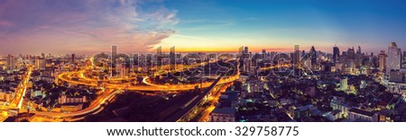 Bangkok Expressway top view in panorama at sunrise, Thailand. - stock photo