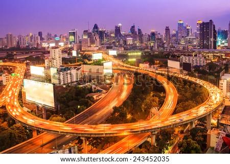 bangkok expressway with cityscape at dusk - stock photo