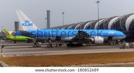 BANGKOK - FEB 20: Airplanes wait at boarding gates at Suvarnabhumi International Airport on Feb 20, 2014 in Bangkok, Thailand. The airport handles 45 million passengers annually 2014. - stock photo
