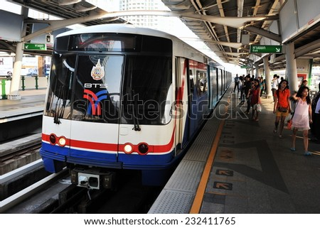 BANGKOK - FEB 22: Passengers leave a platform at a BTS Skytrain station in the city centre on Feb 22, 2012 in Bangkok, Thailand. Founded in 1999, the BTS has a daily ridership of 600,000.