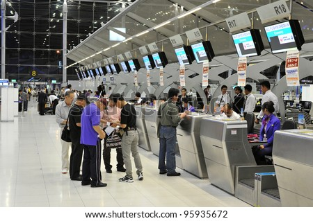 BANGKOK - FEB 9: Unidentified passengers arrive at the check-in counters at the new Suvarnabhumi Airport, Feb 9, 2012 in Bangkok, Thailand. The airport is one of the busiest in Asia, handling about 45 million passengers annually. - stock photo