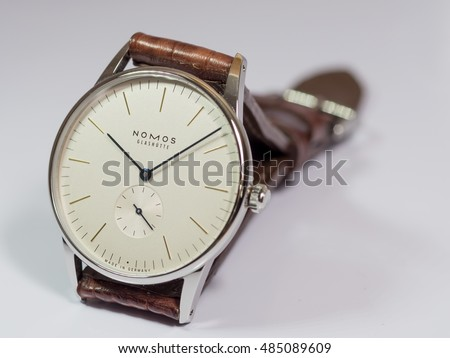 BANGKOK - FEBRUARY 9 : Nomos dress watch, silver dial with blued steel hands and second subdial, winding movement,selective focus on its brand name, was taken on February 9, 2016, in Bangkok, Thailand