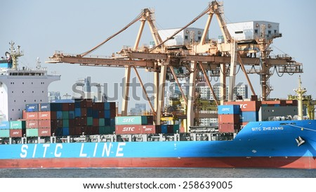BANGKOK, February 26,2015: Port Authority of Thailand Klongtoey. The biggest port in Bangkok with loaded freight ship and cargo handling equipment on the side of Chao Phraya river. Bangkok,Thailand.