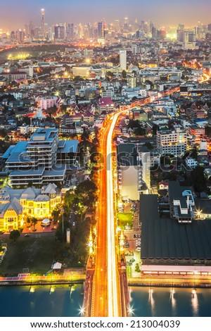 Bangkok Highway across the Chao Phraya river at dusk (Thailand) - stock photo