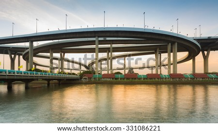 Bangkok highway ring road waterfront view during sunset - stock photo