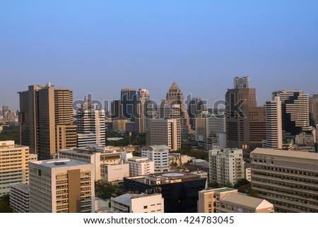 Bangkok in the evening.  Panoramic and perspective view  light blue background of glass high rise building skyscraper commercial  of future. Business concept of success industry tech architecture