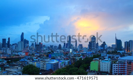 Bangkok in the evening sunset. Panoramic and perspective view light blue background of glass high rise building skyscraper commercial of future. Business concept of success industry tech architecture