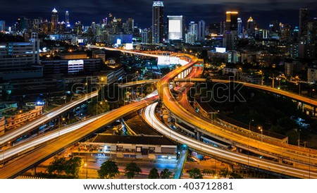 Bangkok  interchange overpass and elevated road in nightfall Bangkok city - stock photo