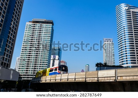 BANGKOK - 15 JAN 2015: A BTS Skytrain on elevated rails in jan 15, 2015 in Bangkok, Thailand. Each train of the mass transport rail network can carry over 1,000 passengers. - stock photo