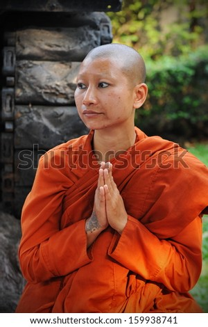 BANGKOK - JAN 25: A Buddhist monk prays while attending a pilgrimage through the Thai capital on Jan 25, 2013 in Bangkok, Thailand. 1,128 monks have joined the pilgrimage of over 26 days and 446 km. - stock photo