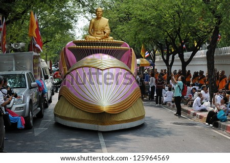 BANGKOK - JAN 25: A decorated vehicle carrying a statue of Phra Mongkhonthepmuni leads a pilgrimage of Buddhist monks through central Bangkok on Jan 25, 2013 in Bangkok, Thailand. - stock photo