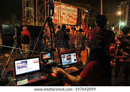 BANGKOK - JAN 29: An unidentified video editor operates an editing system during a large city center red-shirt rally on Jan 29, 2013 in Bangkok, Thailand. - stock photo