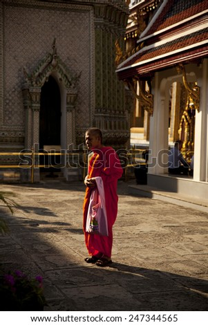 BANGKOK - JAN 3 : Buddhist monks visiting Grand Palace on January 3,2015 in Bangkok, Thailand. The most famous Thai temple Wat Pra Keaw situated in the Grand Palace area. - stock photo