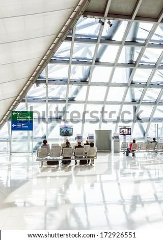 BANGKOK - JAN 5: departure terminal of Bangkok Suvarnabhumi International Airport on January 5,2010 in Bangkok, Thailand. The airport is handling about 45 million passengers annually. - stock photo