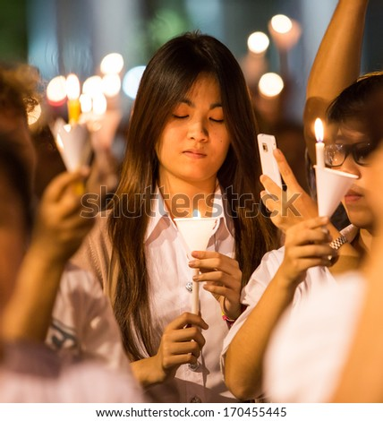 Bangkok - 09 JAN : Group of people in white informal suit lighting a candle for show the symbol about the respect for vote election on 2 February 2014. On January 09, 2014 in Bangkok, Thailand