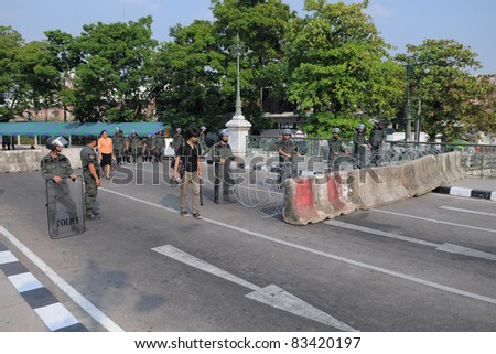 BANGKOK - JAN 25: Police Commandos guard a barricade on Makkhawan Bridge outside Government House on Jan 25, 2011 in Bangkok, Thailand. Bangkok continues to see street protests and bomb alerts. - stock photo