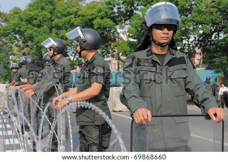 BANGKOK - JAN 25: Police Commandos guard a barricade on Makkhawan Bridge outside Government HQ on Jan 25, 2011 in Bangkok, Thailand. The Thai capital continues to see street protests and bomb alerts. - stock photo