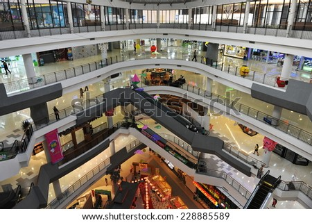 BANGKOK - JAN 22: View of the interior of the Gateway Ekamai shopping mall on Jan 22, 2013 in Bangkok, Thailand. The Japanese themed mall has features 400 stores over 8 floors. - stock photo