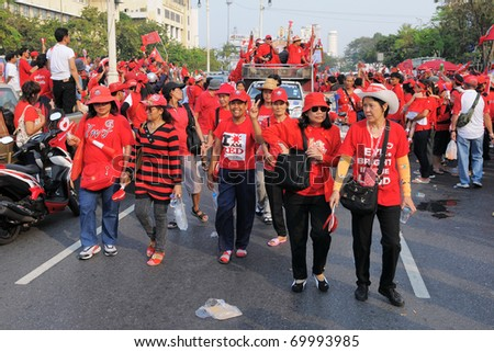 BANGKOK - JANUARY 23: Anti-government red-shirts arrive at a rally at Democracy Monument on January 23, 2011 in Bangkok, Thailand. The red-shirts are calling for political change and fresh elections. - stock photo