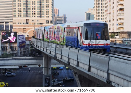 BANGKOK - JANUARY 7: BTS Skytrain on elevated rails in the city centre January 7, 2011 in Bangkok, Thailand. The rail network recently marked its 10th year of operations in the Thai capital. - stock photo
