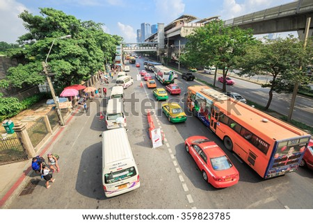 BANGKOK - JANUARY 3 :Cars, buses, taxis and people crowd on street at Chatuchak market Bangkok on January 3,2016.Chatuchak is the largest market in Thailand and the world's largest weekend market.