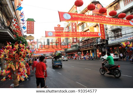 BANGKOK - JANUARY 23 : Chinese New Year 2012 - People walking through the busy streets in Chinatown, Bangkok, Thailand. 23 Jan 2012 - stock photo