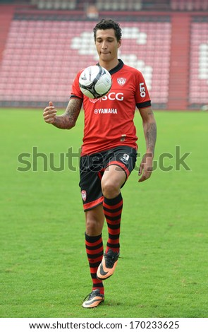 BANGKOK - JANUARY 8: Jay Bothroyd footballer from England in action during opening the new player of Muangthong United at SCG Stadium on January 8, 2014 in Bangkok.  - stock photo