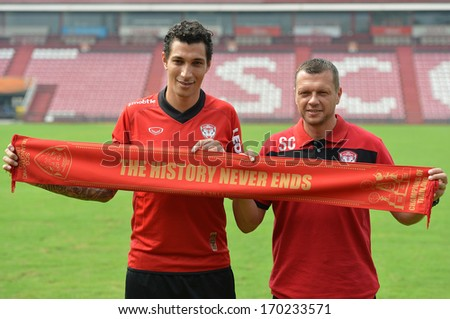 BANGKOK - JANUARY 8: Jay Bothroyd (L) footballer from England poses during opening the new player of Muangthong United at SCG Stadium on January 8, 2014 in Bangkok.  - stock photo