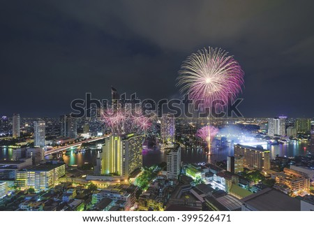 BANGKOK - JANUARY 1: New year countdown celebration fireworks along Chaophraya river, view from Taksin bridge in Bangkok, Thailand, on January 1, 2016.