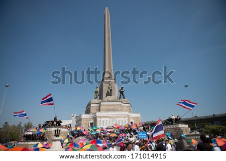 BANGKOK - JANUARY 13, 2014 : Protesters gathered at Victory Monument. Protesters set to paralyze Thailand's capital for at least 15 days from Monday to pressure PM Shinawatra to step down.