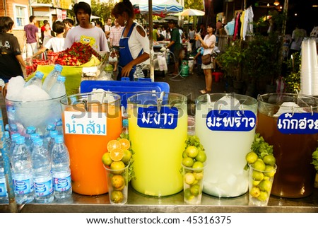 BANGKOK - JANUARY 24:  Street vendors selling food at the Chatachuk Weekend Market during street vending January 24, 2010 in Bangkok, Thailand.  Street vending is a popular tourist attraction. - stock photo