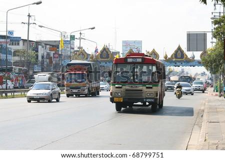 BANGKOK - JANUARY 5: Traffic driving up the road in Rangsit on January 5, 2011 in Bangkok, Thailand. - stock photo