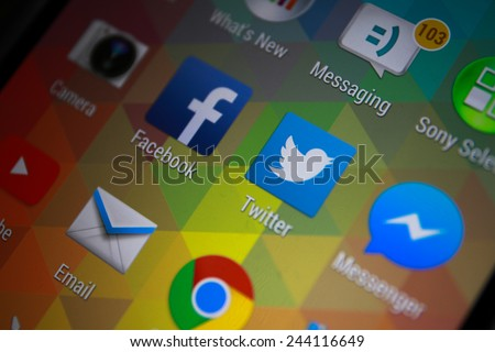 """BANGKOK-JANUARY11 2015: Twitter Icon on Phone. Twitter is an online social networking service that enables users to send and read short 140-character messages called """"tweets"""". - stock photo"""