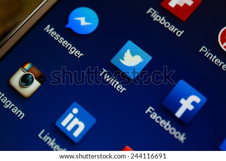 "BANGKOK-JANUARY11 2015: Twitter Icon on Phone. Twitter is an online social networking service that enables users to send and read short 140-character messages called ""tweets"". - stock photo"